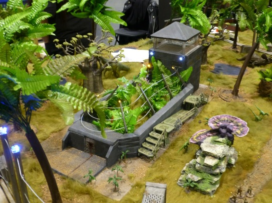Military installation in a jungle with roaming dinosaurs