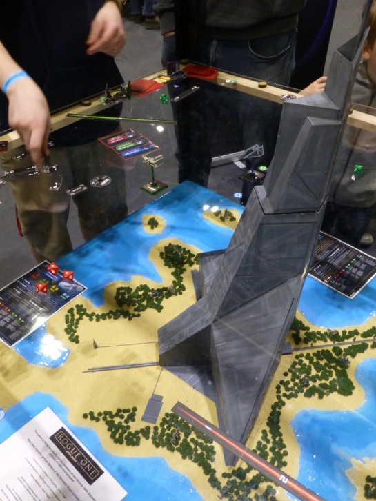 A tower rising up from a small island, surrounded by space fighter craft
