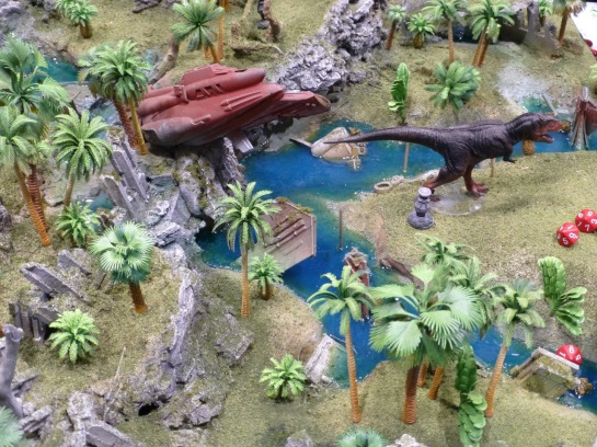 Jungle terrain with a crashed space craft and large dinosaur