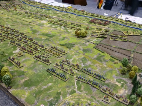 Countryside battlefield with two large armies lined up using small scale miniatures
