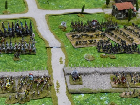 Troops behind defensive earthworks waiting for an attack through a vineyard