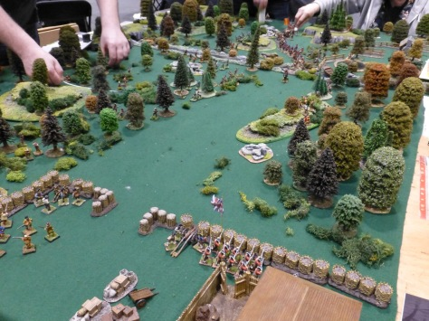 Trading post defender by British troops in a wooded area