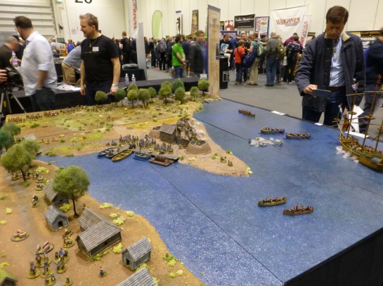 Wargames table showing a coastline with boats approaching