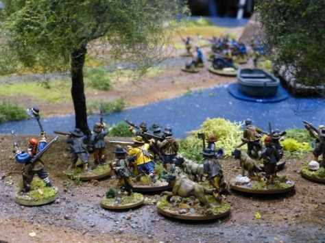 A small band of irregular troops under trees
