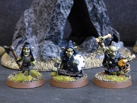 Three goblins with axe, sword and shield and skull drum respectively