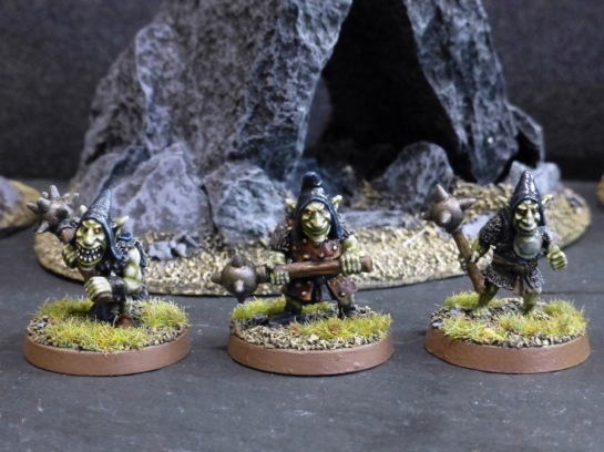 Three goblins with spiked maces