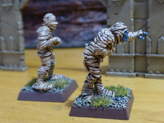 Side view of two walking mummies