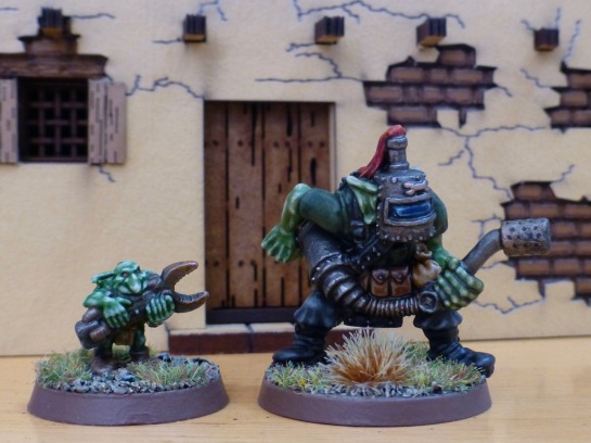 Space Ork with flamethrower and welding mask accompanied by Gretchin with large spanner