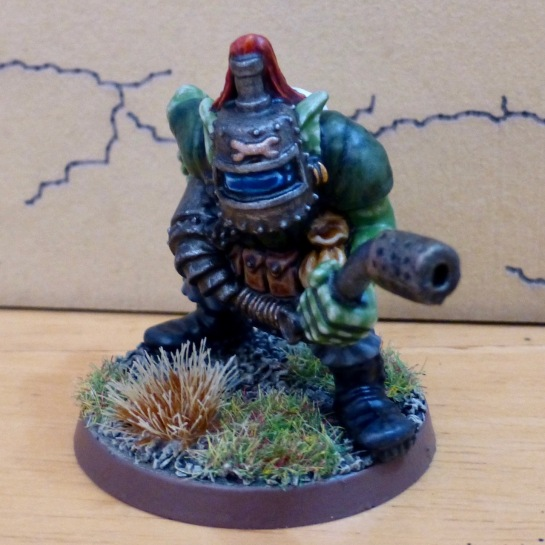 Front view of Space Ork with cracked welding mask holding flamer nozzle