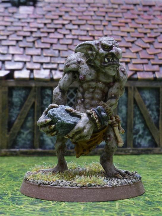 Pale skinned troll holding a big rock