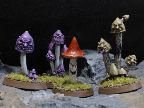 Long stalked mushrooms of various colours with grinning faces