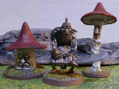 Two giant red capped mushrooms with faces flanking a troll with a helmet and large sword