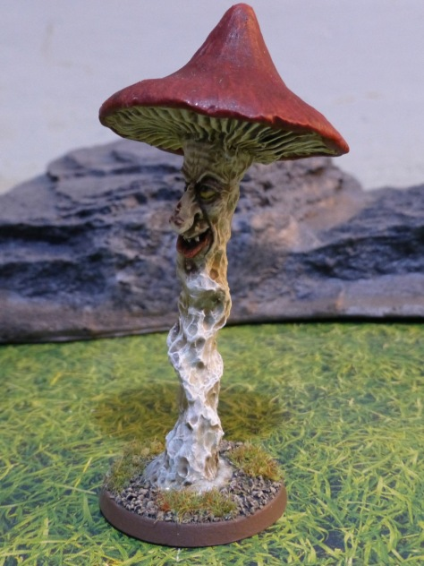 Tall and slender mushroom with a snarling grin and large red cap