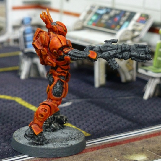 Side view of Mobile Brigada with bulky black rifle in right hand