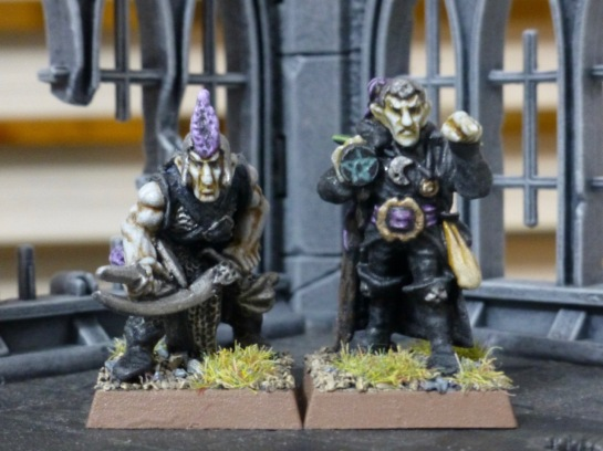 Dark Elf miniatures inside the model of a gothic ruin