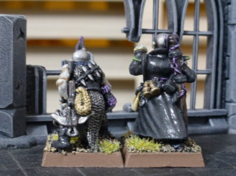 Back view of the Dark Elves, showing equipment like rope, crossbow, daggers and vials