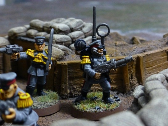 Soldiers in a trench with radio operator