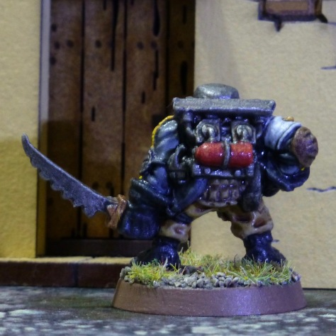 Back view of Space Ork with metal contraption and gas cylinder