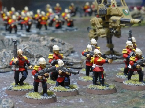 Squad of soldiers in tropical helmets with red jackets and laser rifles