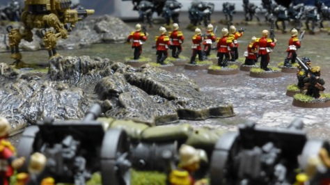 Squad of soldiers from behind in the distance with two laser cannons in the foreground