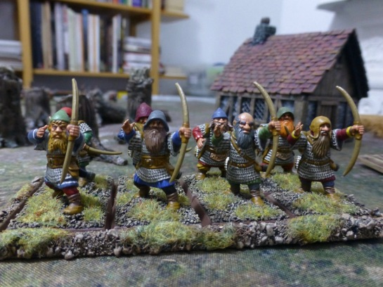 Group of eight dwarfs in chainmail with long bows