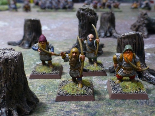 Four dwarfs with longbows amidst felled trees