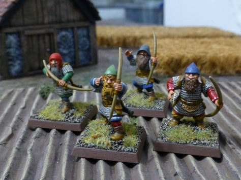 Four dwarfs with longbows in a ploughed field