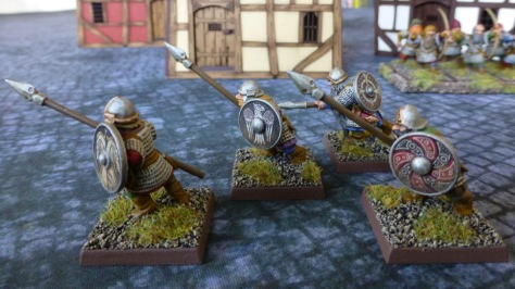 Side view of four dwarfs with spears and shields