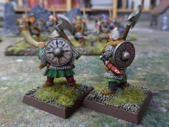 Back view of two dwarfs with richly decorated shields