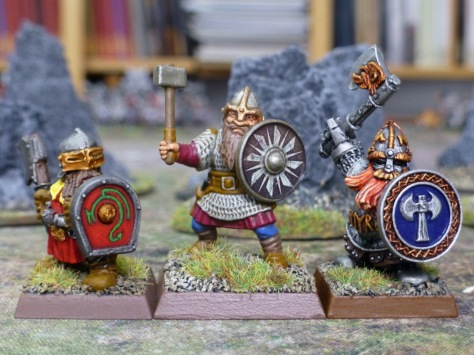 Three medieval dwarfs of different styles next to each other