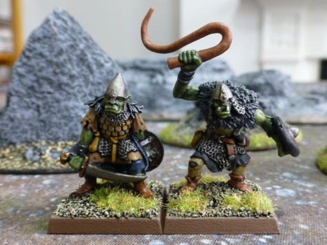 Two goblins, one armed with the sword, the second with heavy whip