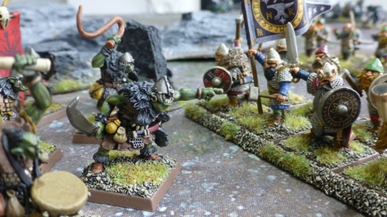 Loose line of goblins with pointing leader at the front facing regiment of dwarfs