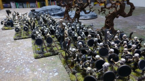 Line of skeletal warriors advancing across rough ground