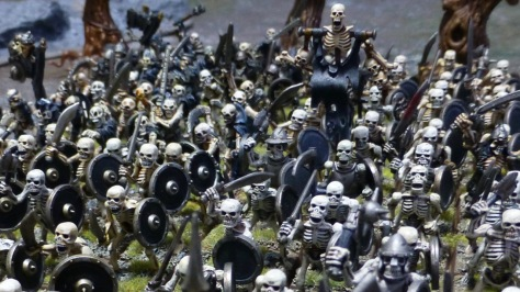 View down onto dense ranks and files of skeleton warriors