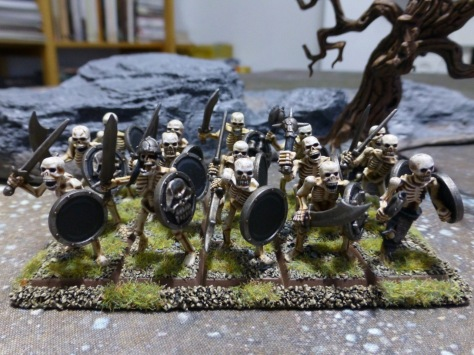Fifteen skeletons in three ranks with shields and handweapons