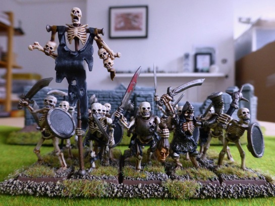 Rank and file skeletal warriors marching under a black banner