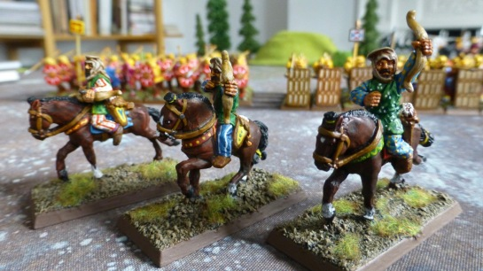 Three colourfully dressed horse archers