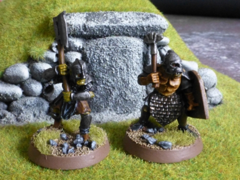 Two orcs in front of a barrow mound