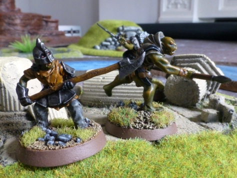 Two orcs with spears in front of broken columns