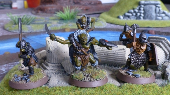 Group of five orcs amongst broken pillars with a river in the background