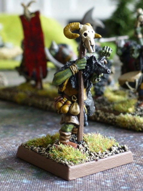 Goblin shaman wearing a wolf pelt and holding a staff with a ram's skull