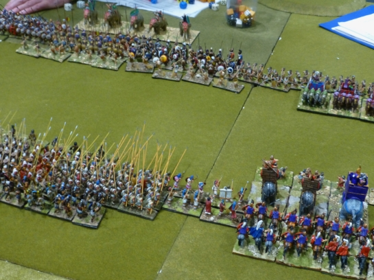 Two battle lines facing off with pikes, cavalry, chariots and elephants