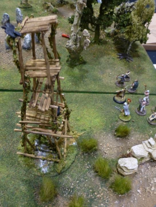 Celtic warriors advancing towards a wooden watchtower