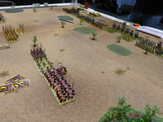 Macedonian cavalry and infantry advancing towards massed enemy lines