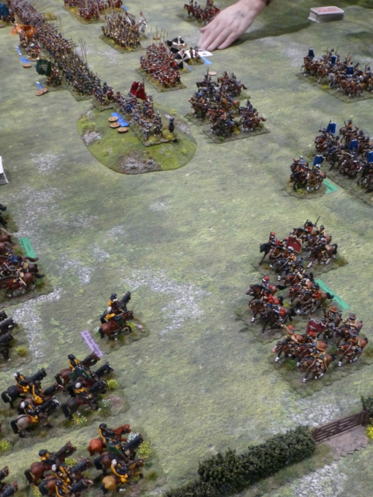 Cavalry units charging at each other over open ground