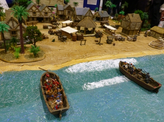 Two boats filled with pirates landing on a beach