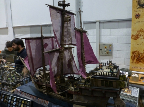 Pirate ship model with three masts and purple sails