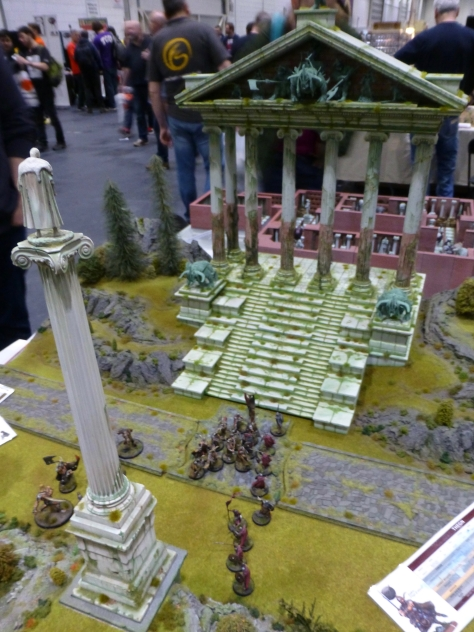 Front of a large classical temple with warbands fighting for access