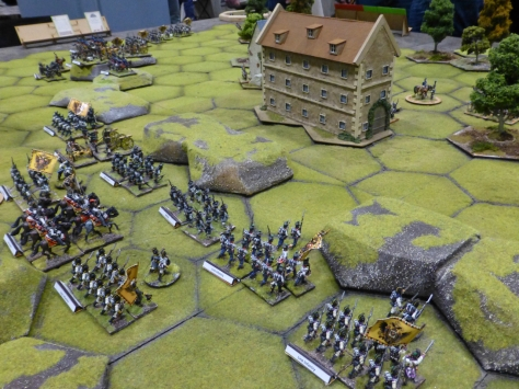 Massed units of troops marching towards a house