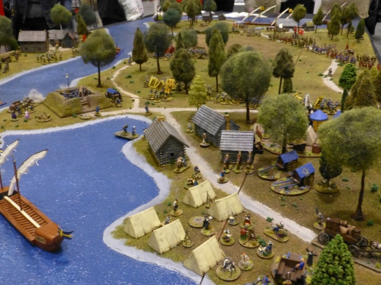 A small settlement and tents set up along the shore